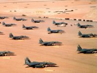 F-15E Strike Eagles from Seymour Johnson AFB are parked on an uncovered, desert airfield during Operation Desert Shield.